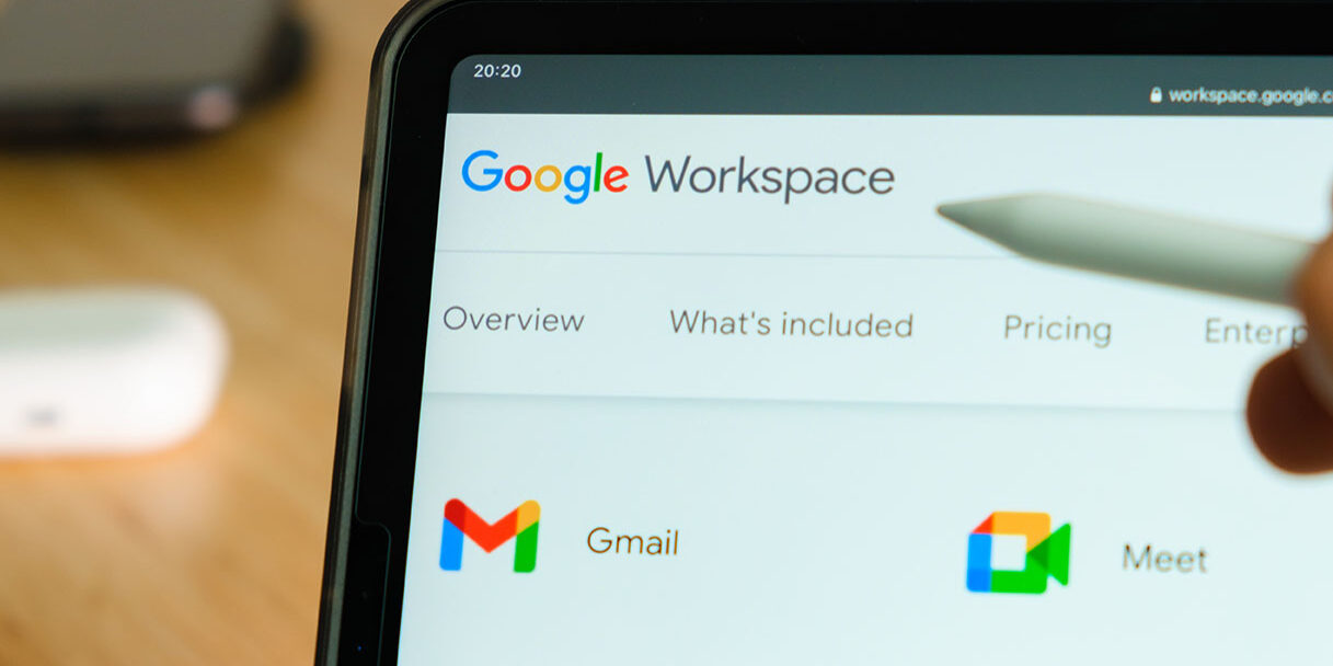 Google Workspace logo shown by apple pencil on the iPad Pro tablet screen. Man using application on the tablet. December 2020, San Francisco, USA.